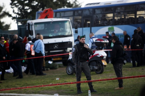 Israeli police investigates the scene of an attack in Jerusalem Sunday, Jan. 8, 2017. A Palestinian rammed his truck into a group of Israeli soldiers in Jerusalem on Sunday, killing four people and wounding 15 others, Israeli police and rescue services said, in one of the deadliest attacks of a more than yearlong campaign of violence. (AP Photo/Mahmoud Illean)