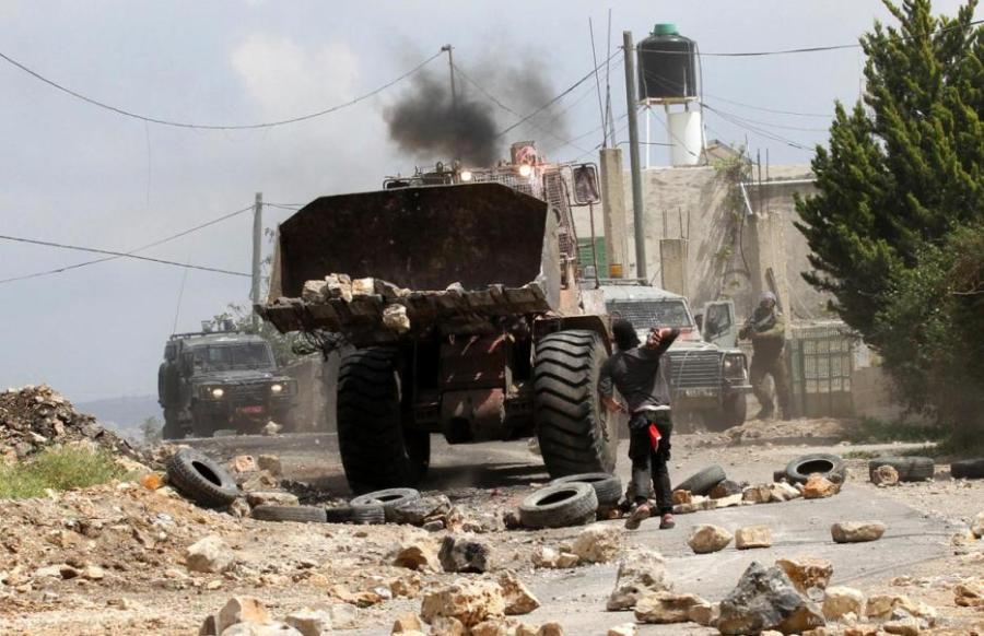 palestinian-protestor-throws-stone-at-israeli-bulldozer-protesting-against-israeli-aggression-near-nablus-west-bank