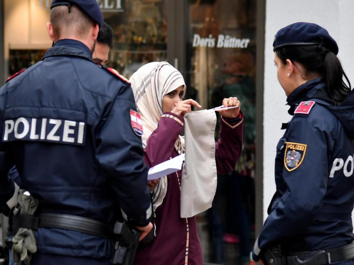 Muslim woman forced to take off niqab by armed police in Austria in the street. Humiliating!