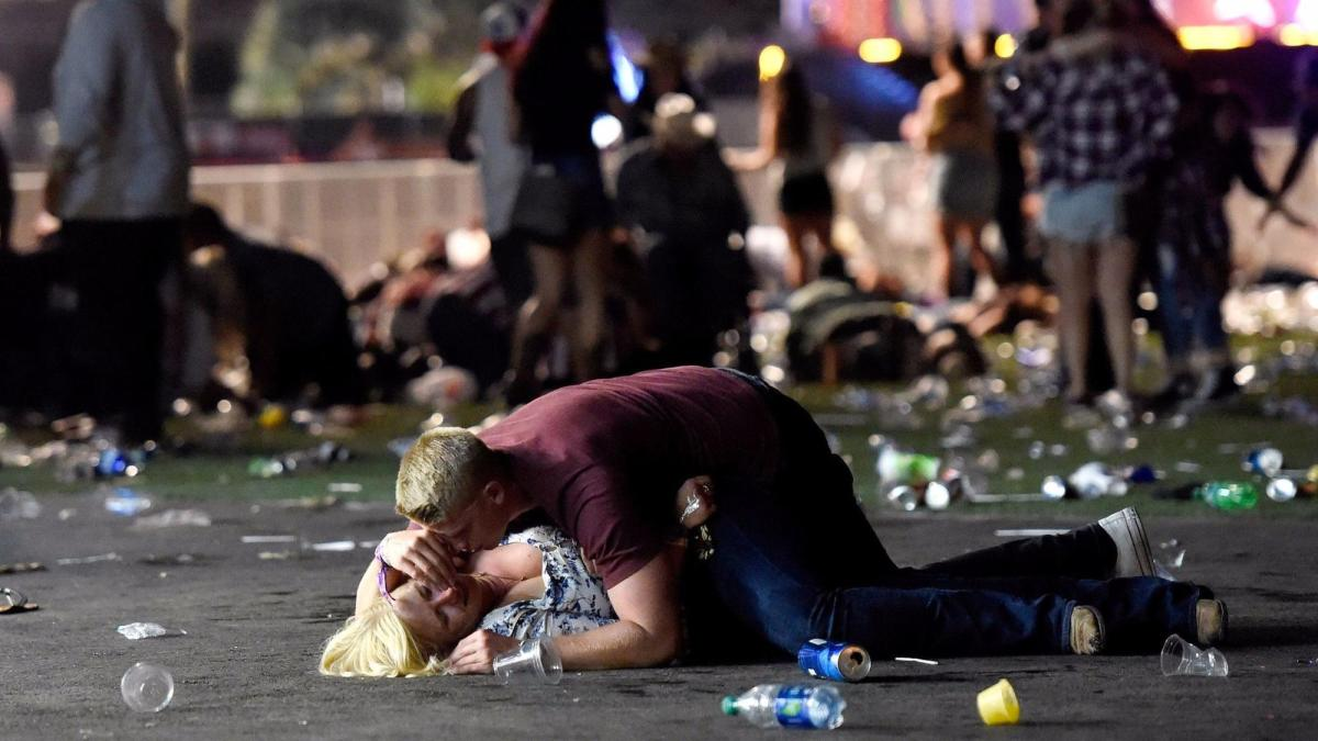 SHOCKING video terrorist shooting at crowd in Las Vegas.. You can hear the gunshots in the background. WARNING! GRAPHIC