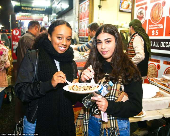 4D0DD9CE00000578-5821997-Two_friends_are_enjoying_a_plate_of_food_at_the_Lakemba_street_f-a-97_1528477030580