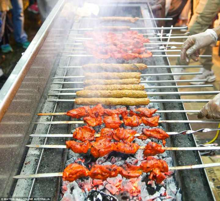 4D0DDD4600000578-5821997-Chicken_shawarma_and_kafta_cooked_over_a_smoky_BBQ_for_a_delicio-a-90_1528477028347